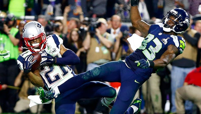 New England Patriots cornerback Malcolm Butler (21) intercepts a pass intended for Seattle Seahawks wide receiver Ricardo Lockette (83) in the fourth quarter in Super Bowl XLIX at University of Phoenix Stadium.