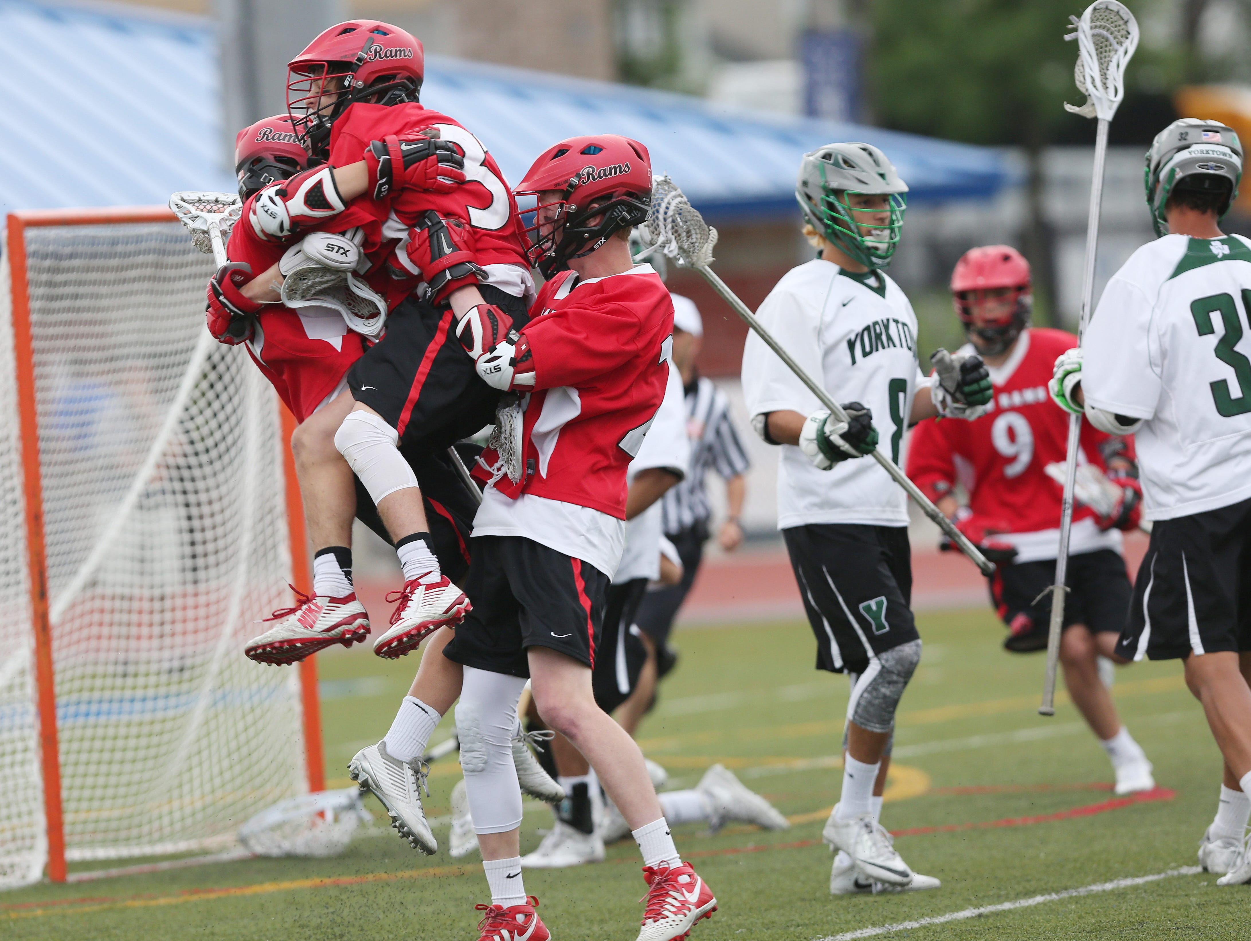 Jamesville-Dewitt players celebrate their first goal, just seconds into the game against Yorktown, during the NYSPHSAA Class B championship lacrosse game at Middletown High School June 11, 2016. Jamesville-Dewitt won the game 9-6.