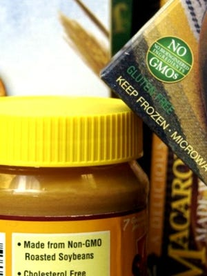 GMO-free: Food on a grocery market shelf is labeled to indicate it is devoid of genetically modified organisms.