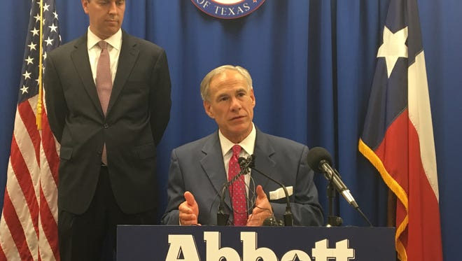 Gov. Greg Abbott announces his intentions to appoint Jimmy Blacklock (left) to the Texas Supreme Court at the Republican Party of Texas headquarters in Austin on Nov. 27.