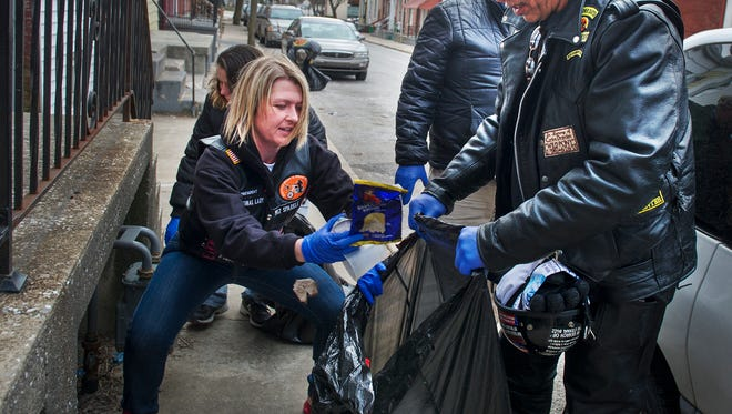 Volunteers helped clean up a neighborhood during the 2014 MLK Day of Service, hosted by Crispus Attucks Association. This year's event is set for Jan. 16.