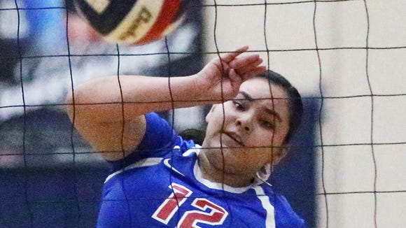 Diamond Lopez, 12, of Bel  Air goes for the kill Tuesday