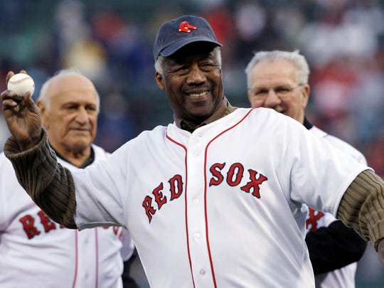 "FILE - In this April 19, 2009, file photo, Boston Red Sox great Elijah ""Pumpsie"" Green throws out a ceremonial first pitch for the Red Sox's baseball game against the Baltimore Orioles in Boston. Green, the first black player on the Red Sox, has died. He was 85. A Red Sox spokesman confirmed his death Wednesday night, July 17, 2019. (AP Photo/Charles Krupa, File)"