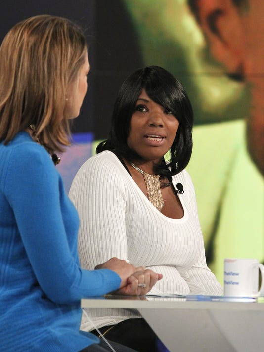 """In this photo provided by ABC, Katina Powell, right, appears on ABC's """"The View"""" with host Paula Faris, left, Friday, Oct. 23, 2015, in New York. Powell and her daughter spoke about her book """"Breaking Cardinal Rules: Basketball and the Escort Queen."""" (Lou Rocco/ABC via AP)"""