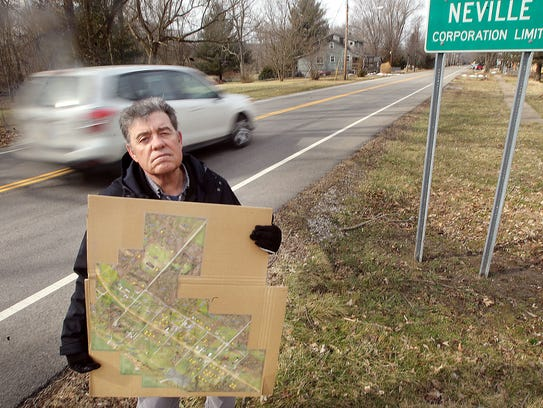 Washington Township Trustee Dennis Cooper holds a map