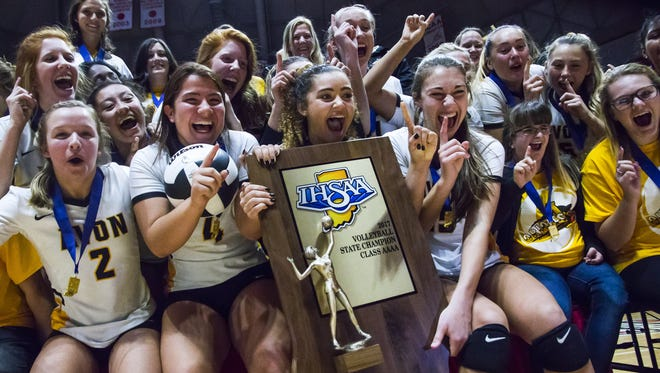The Avon Orioles girls volleyball team celebrates after defeating Crown Point Saturday in the IHSAA Class 4A volleyball state finals at Worthen Arena on the Ball State University campus.