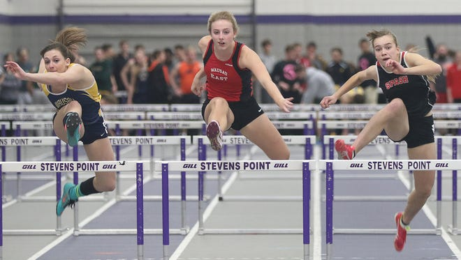 Wausau East's Enne Burton, center, has qualified for the WIAA state track meet the past two seasons and signed her national letter of intent with the University of Wisconsin-Milwaukee on Monday.