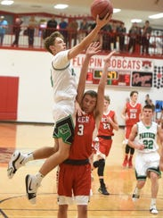 Yellville-Summit's Mason Darnell goes up over Deer's