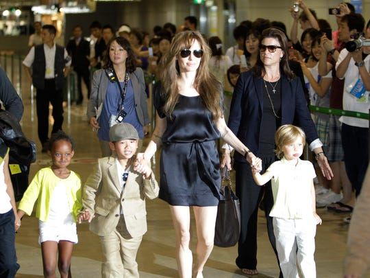 "Angelina Jolie adopted three of her children (from left), Maddox, Zahara Marley and Pax Thien, who walk with sister Shiloh Nouvel. AP file photo U.S. actress Angelina Jolie, fourth from left, and her children from left, 8-year-old Maddox, Zahara Marley, 6, Pax Thien, 6, and Shiloh Nouvel, 4, arrive at Narita International Airport in Narita near Tokyo Monday, July 26, 2010 for the Japan premiere of her spy action-thriller film ""Salt."" (AP Photo/Koji Sasahara)"