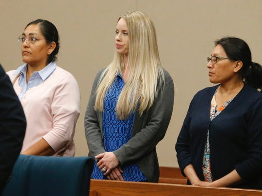 Mistie Lopez, center, the wife of defendant Hisaias Justo Lopez, stands in court Friday. A mistrial was declared in the murder case against her husband in the 210th District Court.
