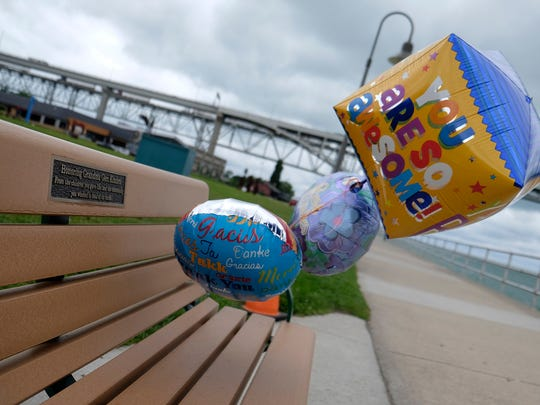 """A plaque mounted to a bench along the St. Clair River reads """"Honoring Grandma Geri Kimbro, From the children you gave life, and the community you worked to heal of its strife."""" The bench was dedicated to Geraldine """"Grandma Geri"""" Kimbro in a ceremony July 24."""