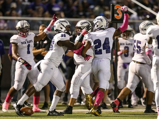 The Ben Davis Giants celebrate a possession turnover during second quarter game action at Lawrence Central High School, Indianapolis, Friday, Oct. 6, 2017.