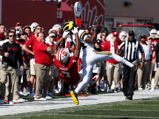 Michigan cornerback Lavert Hill intercepts a pass intended for Indiana receiver Taysir Mack on Oct. 14.