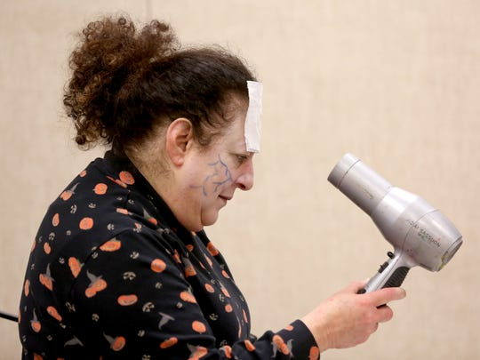 Elaine Kevorkian, 62, of Salem, uses a hairdryer to