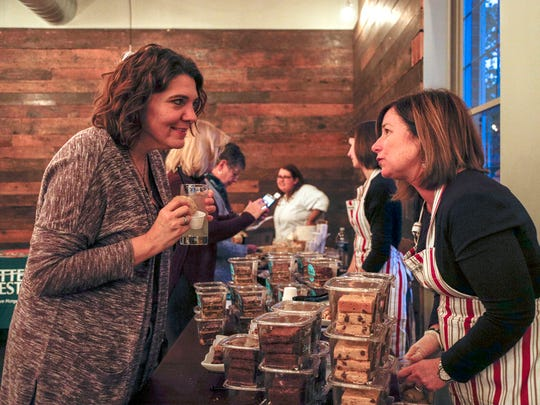 Kat Smith of Shelby Township, left, talks to Ethel's Baking Co.'s Jill Bommarito during the second annual Whisked: A Holiday Baking Event presented by the Detroit Free Press and the Metro Detroit Chevy Dealers.