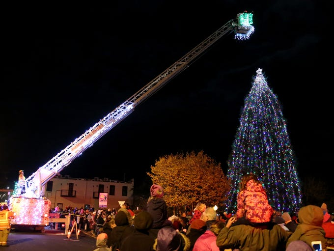A Silverton Fire District engine lifts Santa to the