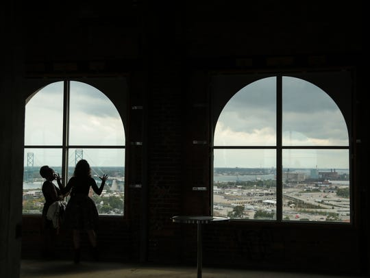 People get a view of Detroit from the 13th floor of Michigan Central Station in Detroit in September 2017 during Crain's Detroit Homecoming IV event.