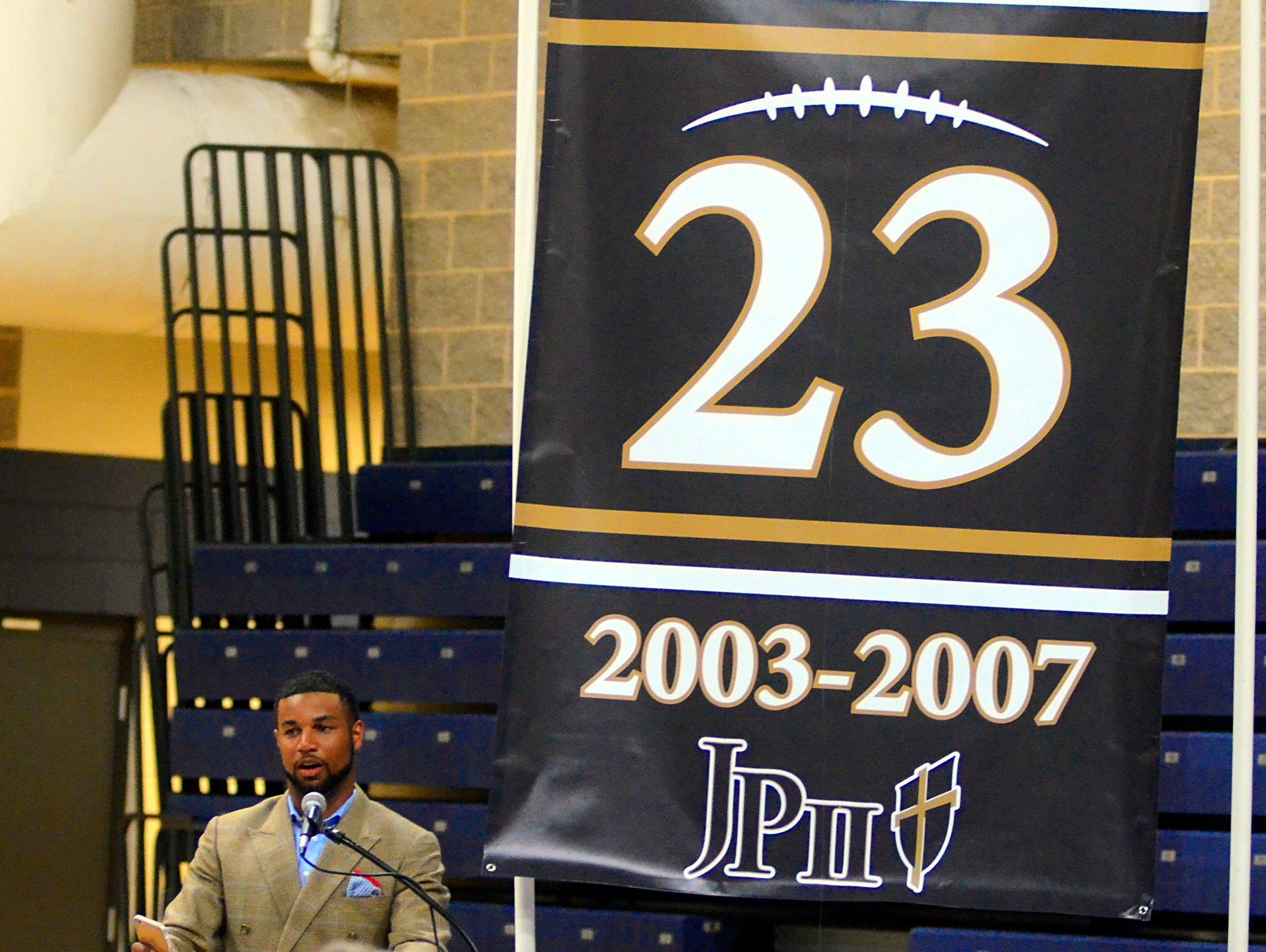 Detroit Lions wide receiver Golden Tate speaks during his jersey-retirement ceremony on Thursday evening at Pope John Paul II High.