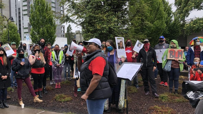 Jennifer Scurlock, the director of the National Education Association and an English teacher at Churchill High School in Eugene's 4J School District, spoke at the courthouse before the march commenced Friday.