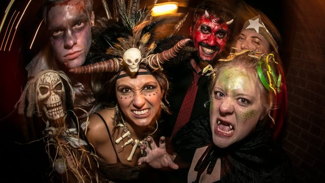 Costumed revelers pose for a photo at Creepy Cheapy.