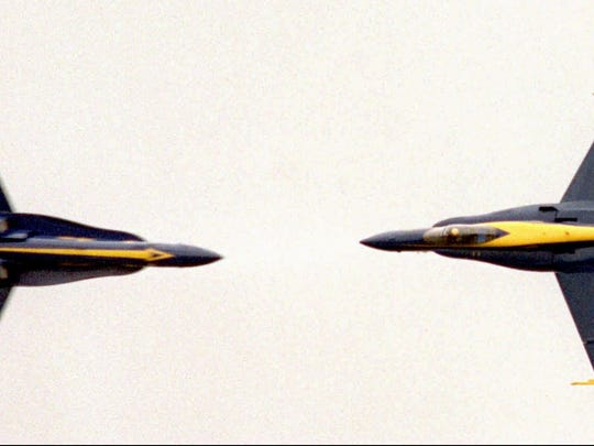 Two F/A-18 Hornets of the Blue Angels flying team perform a head on maneuver during a practice session Thursday, July 18, 1996 in Dayton, Ohio, in preparation for the Dayton Air Show on July 20-21. (AP Photo/Keith Ciriegio)DY101