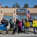 Hundreds show up for protest in front of Pearce office