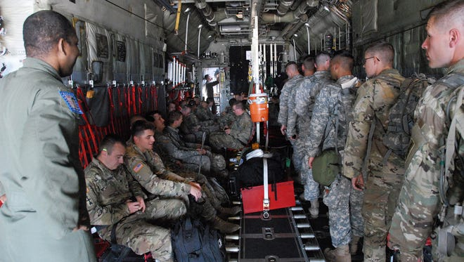 Members of the Wisconsin Army National Guard's 32nd Infantry Brigade Combat Team board a military transport aircraft at Volk Field, Wis., on Monday, Sept. 11, en route to Florida to help with Hurricane Irma relief efforts there.