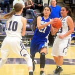 Carlsbad's Mariel Gomez splits Clovis defenders Jaci Severs, left, and Serena Garcia in the second half of Tuesday's district game.
