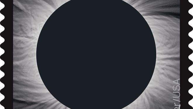 The U.S. Postal Service will commemorate the Aug. 21 total solar eclipse by issuing a first-of-its-kind stamp using thermochromic ink that changes when you touch it, transforming from an image of the sun in eclipse into an image of the moon from the heat of a finger.