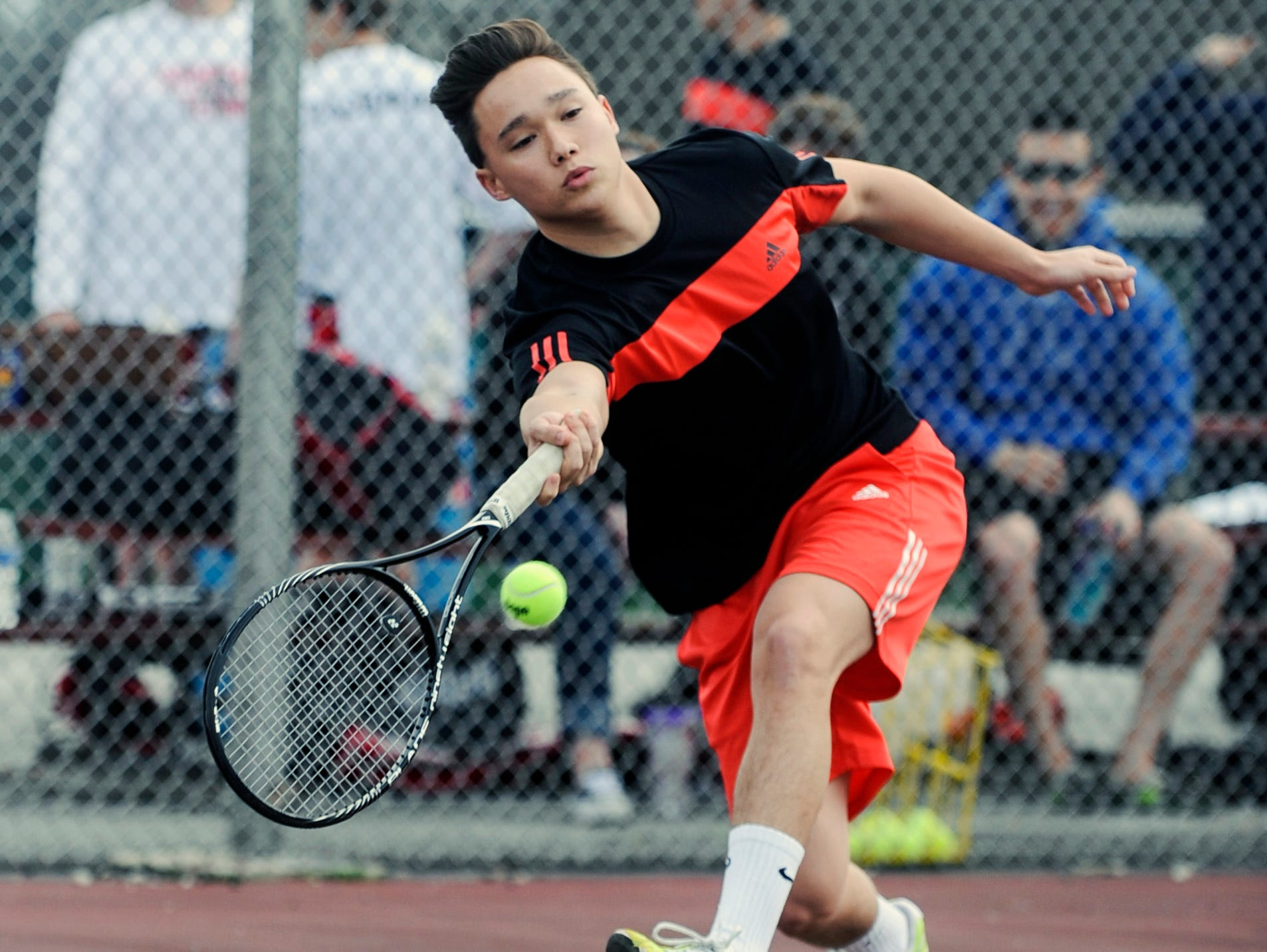 Pleasant's Christian Vaflor stretches out to return a serve from Harding's Win Adissem during their match at Pleasant High School on Tuesday, April 14, 2015.