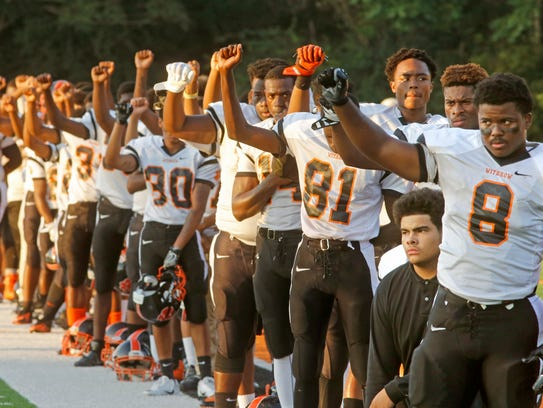 While a few players kneeled, most of the Withrow High