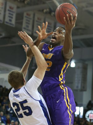 Northern Iowa forward Marvin Singleton goes up for a shot in the lane over Drake defender Chris Caird during Saturday's 64-40 Panthers win. Singleton tallied nine points, seven rebounds and four assists as the Panthers improved to 14-2 and 3-1 in Missouri Valley Conference play.