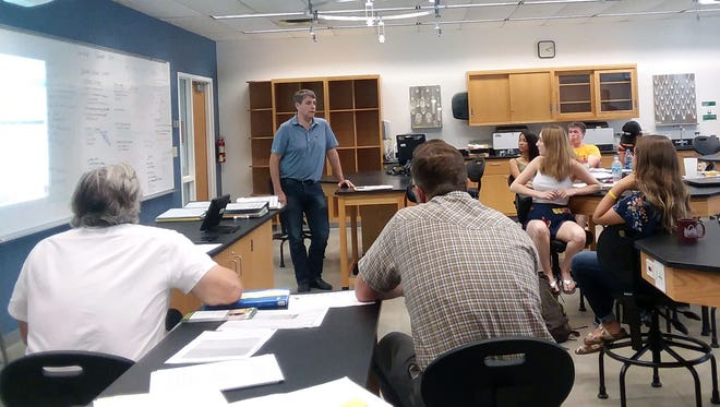 Democratic candidate for Iowa Secretary of Agriculture Tim Gannon listens as stuents at Simpson College tell him about their project studying Palmer Amaranth and other herbicide-resistant weeds.