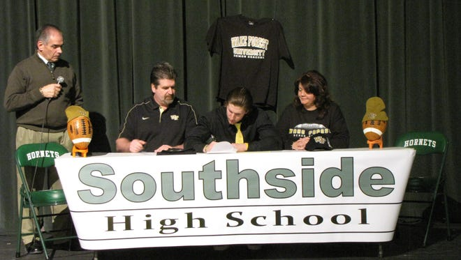 Mike Weaver signs a national letter of intent  to play football at Wake Forest University. Also pictured, from left to right, are Southside athletic manager Jim Palmer and parents, Rick and Lori Weaver.