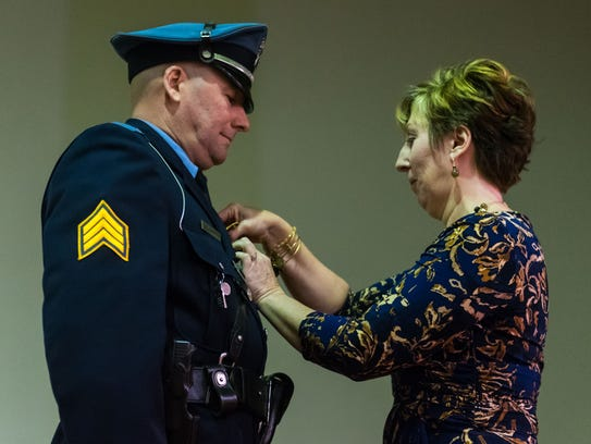 Lieutenant Thomas Riordan is pinned by his wife, Kelly Riordan, during a promotion ceremony at Vineland City Hall on Tuesday, January 16.