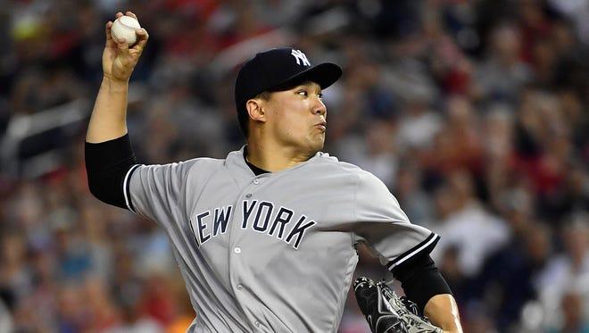 May 15, 2018; Washington, DC, USA; New York Yankees starting pitcher Masahiro Tanaka (19) throws against the Washington Nationals during the third inning at Nationals Park.