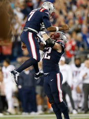 Sep 22, 2016; Foxborough, MA, USA;  New England Patriots guard Joe Thuney (62) lifts quarterback Jacoby Brissett (7) into the air after a touchdown during the fourth quarter against the Houston Texans at Gillette Stadium.  The New England Patriots won 27-0.  Mandatory Credit: Greg M. Cooper-USA TODAY Sports