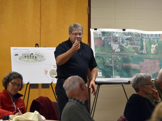 Sturgeon Bay City Engineer Tony Depies helps to answer an audience question at the DOT construction update meeting Monday night at Sturgeon Bay High School.