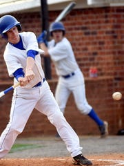 White House High junior Tanner Pharris swings at a third-inning pitch.