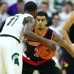 Dec 2, 2015; East Lansing, MI, USA; Louisville Cardinals guard Quentin Snider (2) defends Michigan State Spartans guard Lourawls Nairn Jr. (11) during the 1st half of a game at Jack Breslin Student Events Center. Mandatory Credit: Mike Carter-USA TODAY Sports