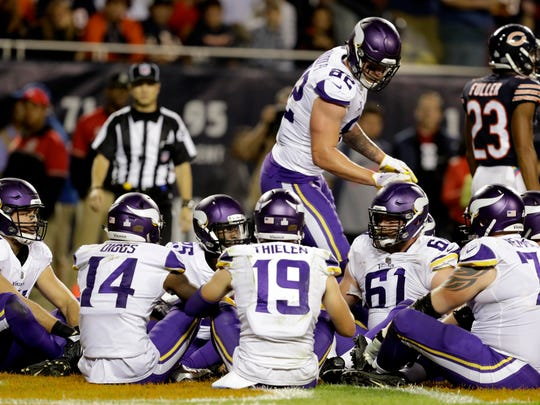 "FILE - In this Monday, Oct. 9, 2017, file photo, Minnesota Vikings tight end Kyle Rudolph (82) celebrates a touchdown with his teammates during the second half of an NFL football game against the Chicago Bears in Chicago. Rudolph initiated a humorous group celebration of his touchdown catch on Monday night with a brief rendition of the children's game ""Duck, Duck, Goose"" in the end zone. Except in Minnesota, the only state where this is the case, the game is called ""Duck, Duck, Gray Duck."""