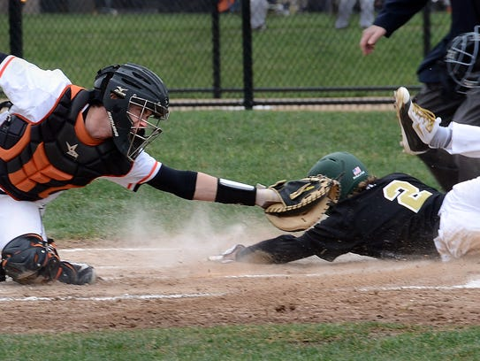 Howell's Johnny Shields slides home against Brighton