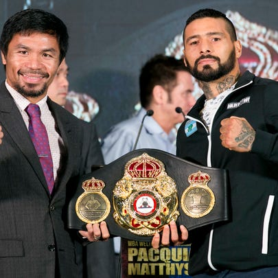 Manny Pacquiao, left, poses with Lucas Matthysse during
