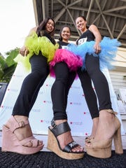 Participants show off their heels prior to running in Macy's 9th Annual High Heel-A-Thon at the Micronesia Mall in this Dec. 2, 2017, file photo.