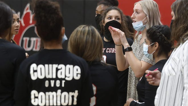 Brownfield High coach Mallorie Ellis  talks to her players during their first set. The Brownfield High School varsity girls played Seminole High School in volleyball Tuesday September 1, 2020 in Brownfield.