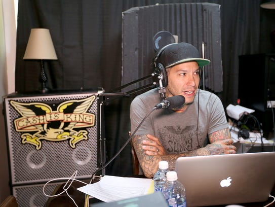 Mike Herrera records a podcast at his studio in Bremerton