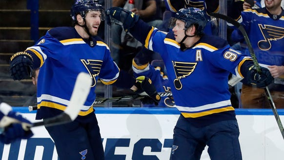 St. Louis Blues' Joel Edmundson, left, is congratulated