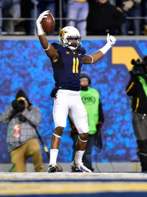 West Virginia receiving threat Kevin White.