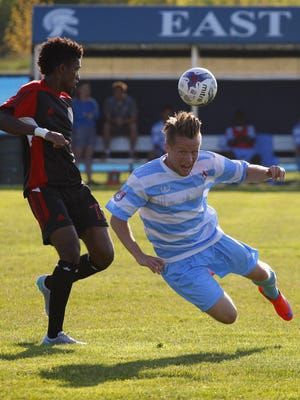 Lansing United's Alec Greene, right, and Michigan Stars' Alexis Sou-Ah-Y battle for the ball Sunday at the East Lansing Soccer Complex. More than 600 fans showed up to watch United's home opener, a 2-2 draw against the Stars. United took a 2-1 lead in the 78th minute on a goal by Danny Cawley, but the Stars' Cody Archibald scored in the 89th minute, tying the game. The United are 1-1 on the season. The next home game in June 3 vs. Grand Rapids FC.