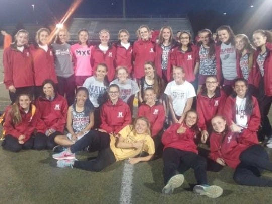 The Milford Mavericks wrapped up the conference girls track championship Tuesday and finished with an undefeated dual-meet record.